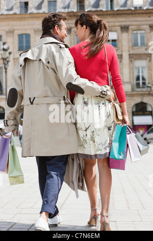 Couple walking on a street, Paris, Ile-de-France, France - Stock Photo