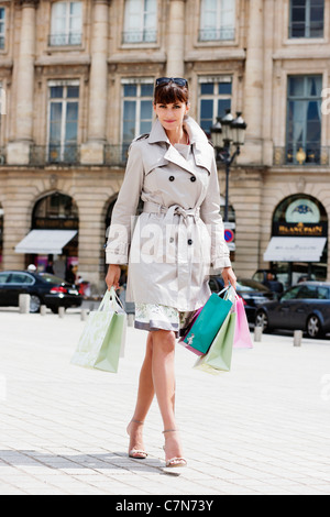Woman walking on a street, Paris, Ile-de-France, France - Stock Photo