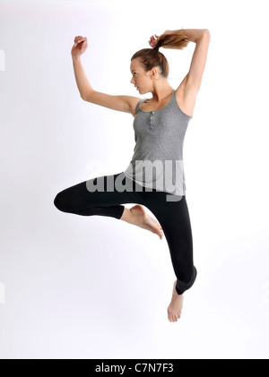 Young woman, 24, jumping - Stock Photo