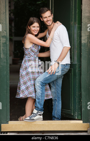 Couple embracing each other at the doorway, Paris, Ile-de-France, France - Stock Photo