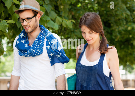 Couple walking together and smiling, Paris, Ile-de-France, France - Stock Photo