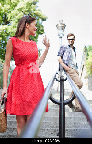 Woman waving to her husband, Montmartre, Paris, Ile-de-France, France - Stock Photo