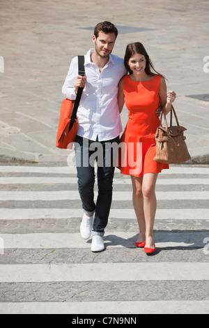 Couple on a crosswalk, Paris, Ile-de-France, France - Stock Photo