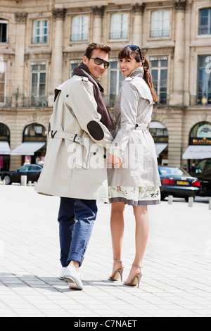 Couple walking on a street, Paris, Ile-de-France, France - Stock Photo