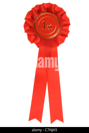 Red first place rosette on white background - Stock Photo