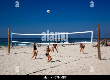 Women playing volleyball on Laguna Beach - CA - Stock Photo