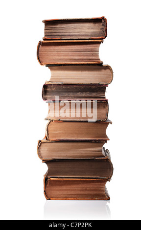 A Stack of old books isolated on white with natural reflection. - Stock Photo