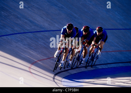 Cycling team competing on the velodrome track. - Stock Photo