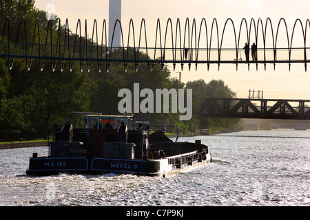 Spiral shaped footbridge. Called 'Slinky Springs to Fame', crosses the 'Rhine-Herne-Canal' an inland waterway. Germany - Stock Photo