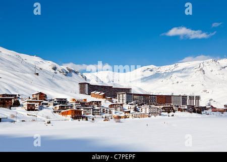 Tignes across Le Lac, Tignes, Savoie, Rhone-Alpes, France - Stock Photo