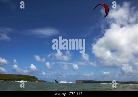 Kite surfer on water under blue sky - Stock Photo