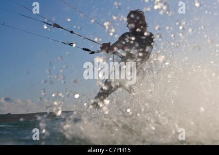 Kite surfer splashing in water - Stock Photo