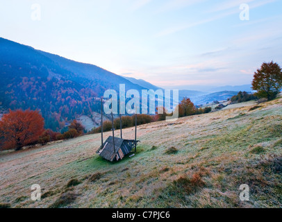 Pink color early daybreak in autumn Carpathian mountain, Ukraine. Stock Photo