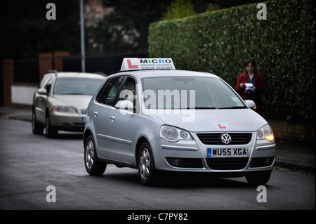 A driving school instructors car in a typically suburban street in England UK - Stock Photo