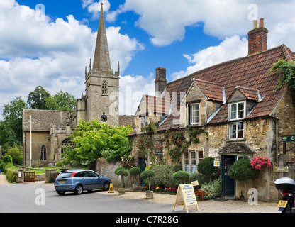 Tea Room and craft shop in front of the Church of St Cyriac in the picturesque village of Lacock, near Chippenham, - Stock Photo
