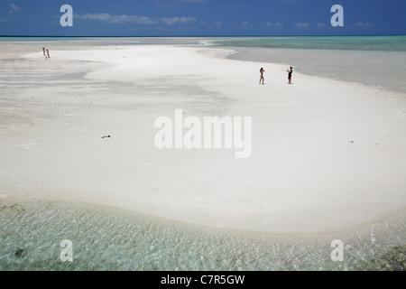 People on the spotless beach of Kapalai Island, Borneo, Malaysia - Stock Photo