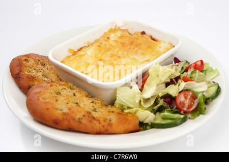 Lasagna pasta garlic bread and salad - Stock Photo