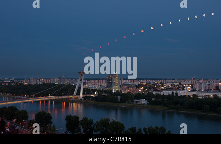 sequence of lunar eclipse seen in Bratislava from 21:20 to 0:10 CET on June 15, 2011 in Bratislava, Slovakia - Stock Photo