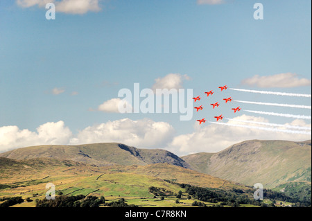 Red Arrows RAF Aerobatic Team fly their Diamond Nine trademark formation above the Troutbeck fells. Windermere Air - Stock Photo