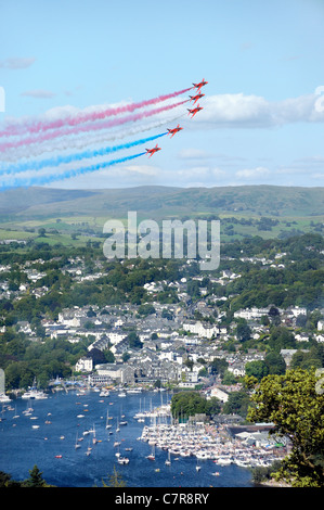 Red Arrows Royal Air Force Aerobatic Team fly in formation above Bowness during Windermere Air Festival, Cumbria, - Stock Photo