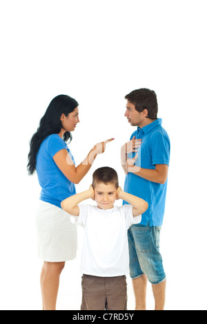 Boy standing with hands on ears and don't wanna hear his parents conflict isolated on white background - Stock Photo