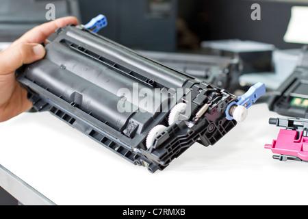 hands repairing laser toner cartridge - Stock Photo