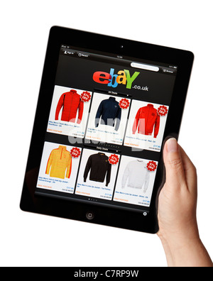 Female hand online shopping holding iPad showing the Ebay store app - Stock Photo