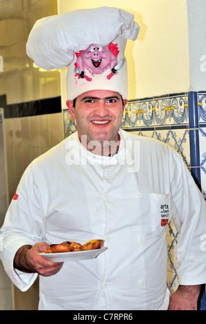 Portugal, Lisbon: Pastry cook Mario Conceicao with the famous 'Pasteis de Belém' in the Antiga Confeitaria de Belém - Stock Photo