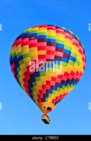 Hot air balloon drifting on a calm sunny afternoon