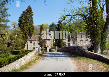 Picturesque scene at Iford of single track road, bridge and Iford manor, taken at Iford, Bradford on avon on fine - Stock Photo