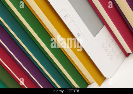 angled row of colour books and e-book