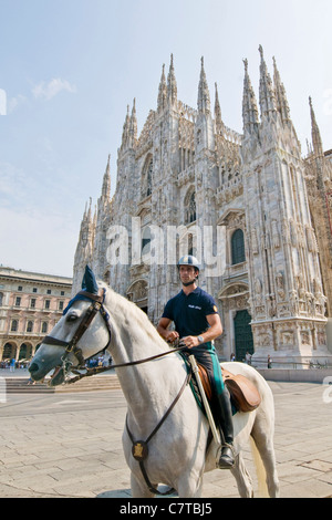 Italy, Lombardy, Milan, Duomo Square, Traffic Policeman on Horseback - Stock Photo