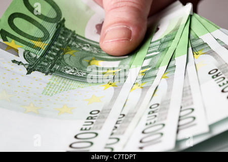 100 euro banknotes in hand close up - Stock Photo