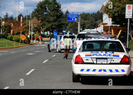 Police car waiting at the Victoria airport. Parked in no parking zone - Stock Photo