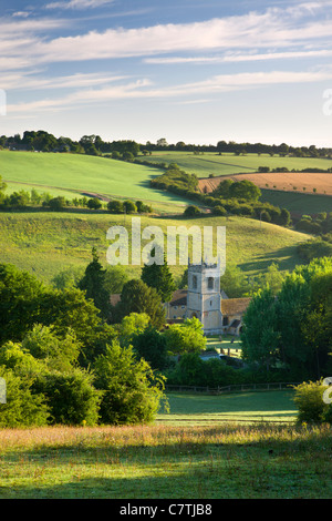Naunton church, nestled in the beautiful rolling Cotswolds countryside, Gloucestershire, England. Summer (July) - Stock Photo