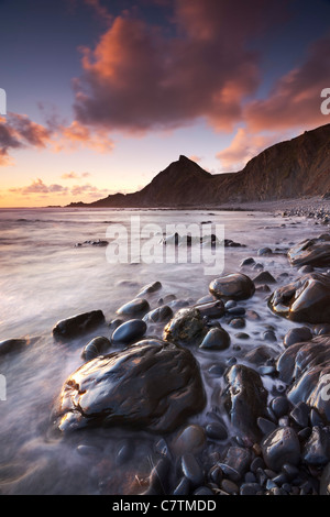 Sunset on the shoreline of Speke's Mill Mouth beach in North Devon, England. Summer (June) 2011. - Stock Photo