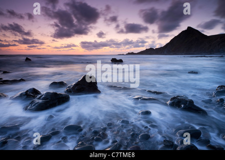 Dusk on the rocky shores of Speke's Mill Mouth in North Devon, England. Summer (June) 2011. - Stock Photo