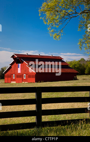 Red barn with American flag near Franklin Tennessee USA - Stock Photo