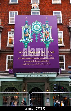 Fortnum and Mason's sign refurbishment of famous clock, Piccadilly, London, England, UK, Europe, England, UK, Europe - Stock Photo