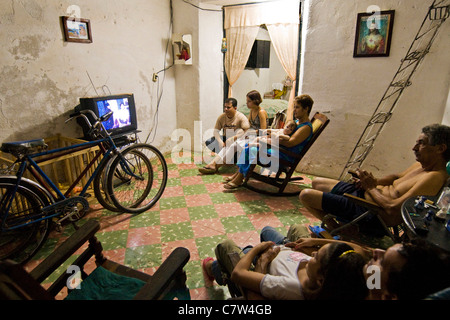 Cuba, Camaguey, family watching tv at home - Stock Photo