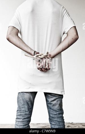 Hand holding syringe - Stock Photo