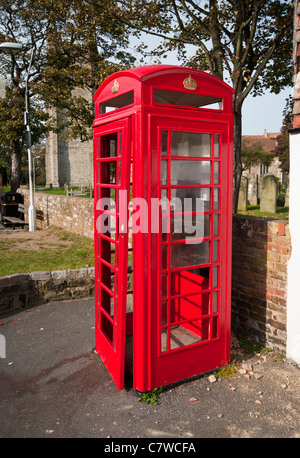 Vandalised Damaged Red UK Telephone Phone Box - Stock Photo