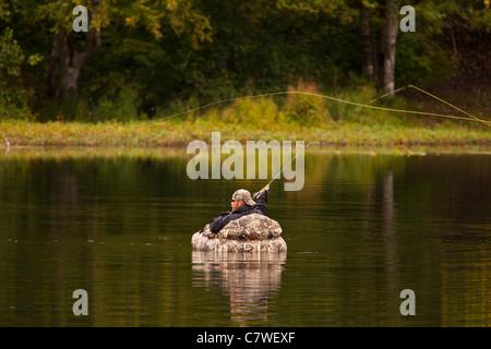 Anchorage alaska usa man fly fishing on pond in for Anchorage alaska fishing