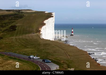 View along coast towards Beachy Head lighthouse, South Downs National Park, near Eastbourne , East Sussex , England - Stock Photo