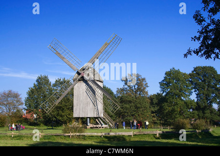 Old windmill in the open-air museum in Cloppenburg in Germany. - Stock Photo