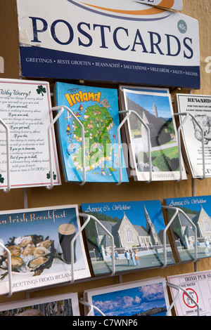 Ireland, Co Wicklow, Avoca, Main Street, postcards for sale outside tourist gift and souvenir shop - Stock Photo