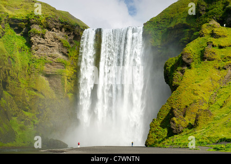 Tourists at Skogar waterfall in southwest Iceland. - Stock Photo