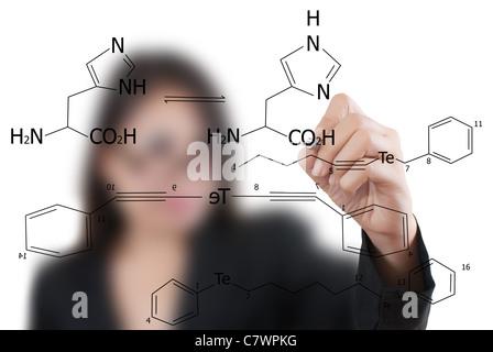 Asian teacher lady writing scientific formula on the whiteboard.