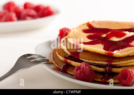 Pancakes Close Up with Raspberries and Syrup - Stock Photo