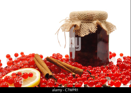 Jar of homemade red currant jam with fresh currant berries - isolated - Stock Photo